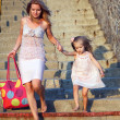 Mother And Daughter Walking To School On Suburban Street — Stock Photo #29343583