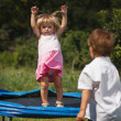 Baby girl jumping on  trampoline — Stock Photo