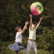 Foto Stock: Multi-ethnic children playing ball