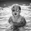 Pretty little girl in swimming pool — Stock Photo #30372993