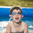 Foto Stock: Boy in water with thumbs