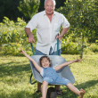 Grandfather giving granddaughter ride — Stock Photo