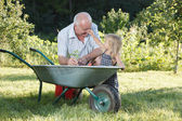 Child is helping her Grandfather — Stock Photo