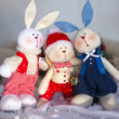 Christmas toy rabbits on the background trees — Stock Photo #33496759