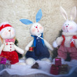Christmas toy rabbits on the background trees — Stock Photo #33496787