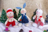 Christmas toy rabbits on the background trees — Foto de Stock