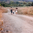 Four children running outdoor — Stok fotoğraf