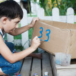 Little boy painting paints — Stock Photo