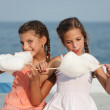 Little girl with cotton candy — Stock Photo