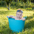 Happy little boy looking out from swimming pool — Stock Photo