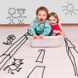 Children ride on the road painted in tub — Stock Photo