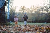 Brother and sister in the autumn park — Stock Photo