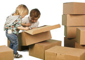 Little boy ang girl plays in boxes — Stock Photo