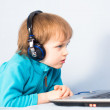 Little kid watching a movie on laptop computer — Stock Photo