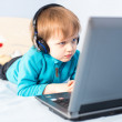 Little boy with laptop — Stock Photo #17162041
