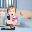Baby boy screaming when playing computer games — Stock Photo #17162107