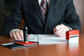 Notary Public in his office signed a contract — Stock Photo