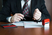 Notary public stamping a document — Stock Photo