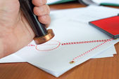 Close-up of notary stamping an important document — Stock Photo