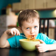 Little boy is eating spaghetti — Stock Photo #19067883