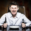 Royalty-Free Stock Photo: Mad man waiting his food