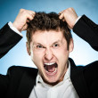 Angry businessman pulls his hair out — Stock Photo
