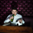 Man with beer and football ball watching TV — Stock Photo