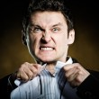 Angry businessman tearing invoice — Stock Photo