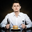 Hungry man is going to eat a burger — Stock Photo