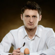 Man opening an egg for eating — Stock Photo