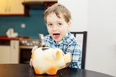 4 year old boy smashed pig piggy bank — Stock Photo