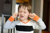 4 year old boy screaming and clog his ears with fingers — Stock Photo
