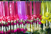 Multi coloured garlands in a row — Stock Photo