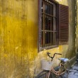 Bicycle under window, Hoi An, Vietnam — Stock Photo #16805659