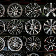 Stock Photo: Shelves of alloy wheels