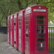 Stock Photo: A row of red phone booths in London