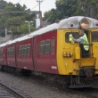 Stock Photo: WELLINGTON, NEW ZEALAND - MAR 1ST: engine driver cleans w