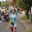 Stock Photo: BALI, INDONESI- JUL 8TH: womcarries basket of fruit to