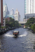 BANGKOK, THAILAND-OCT 27TH: A water bus makes its way along the — Stock Photo