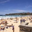 MANLY, AUSTALIA-DECEMBER 08 2013: Manly beach on busy, sunny day — Stock Photo #40683027