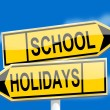 Yellow road signs with inscriptions school holidays — Photo