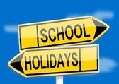 Yellow road signs with inscriptions school holidays — Stock Photo