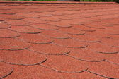 Red asphalt shingle — Stock Photo