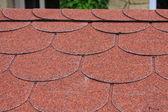Red asphalt shingle — Stock Photo