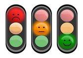 Three traffic lights with smiley faces — Stock Photo