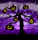 Halloween tree with pumpkins — Stock Vector