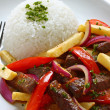 Lomo saltado, peruvian cuisine - Stock Photo