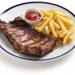 Barbecued pork spare ribs and french fries - Stock Photo