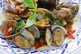 Stir fried clams with roasted chili paste and thai sweet basil — Stock Photo