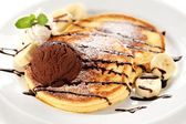 Pancakes with ice cream and chocolate sauce — Stock Photo